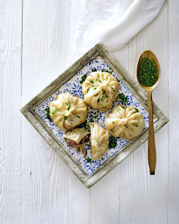 Chinese meat filled dumplings with dipping sauce.