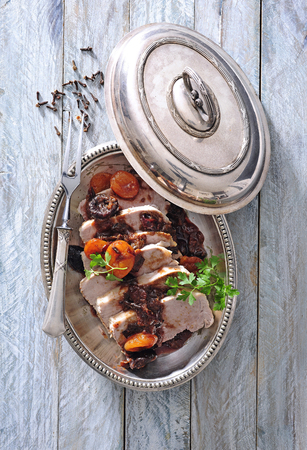 Roast pork loin with sun-dried prunes and apricots spicy sauce.
