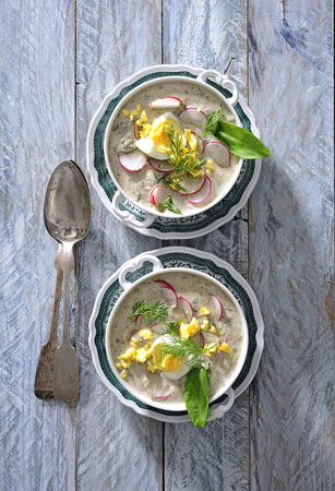 Chowder soup with egg and radish.