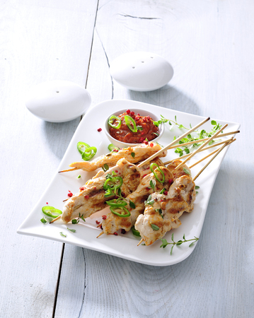Grilled chicken skewers with sun-dried tomato sauce.