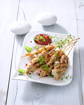 Hot and spicy chicken skewers with sun-dried tomato sauce.