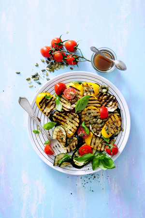 Grilled zucchini and eggplant salad with basil and cherry tomatoes.