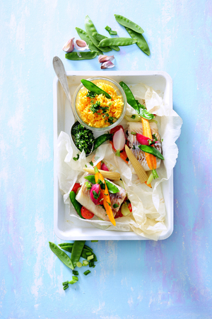 Healthy meal with steamed white fish fillets,  fresh vegetable and rice. 스톡 콘텐츠