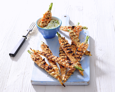Sesame crusted grilled young carrots with greek yogurt dip