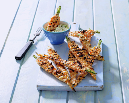 Sesame crusted grilled young carrots with greek yogurt dip.