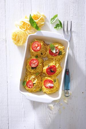 Linguine pasta aglio, olio, parmesan and tomato casserole.