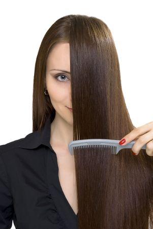 peine: chica con cabello largo casta�o y cepillo Foto de archivo