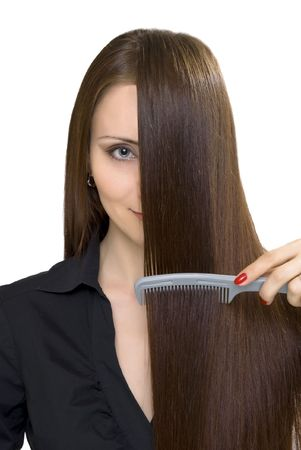 girl with long brown hair and hairbrush photo