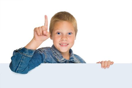 expressing: fun boy in blue jeens, pointing up,expressing attention, isolated on white, horizontal