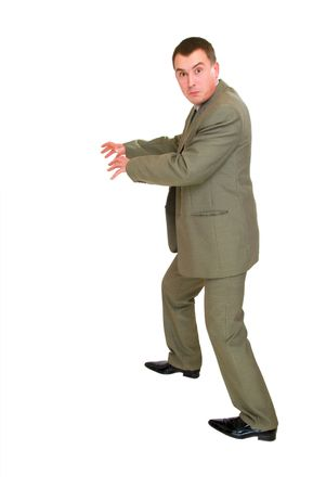 afraid businessman stealing to catch something isolated over white Stock Photo