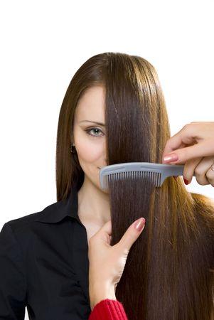 women with hairbrush isolated on white photo