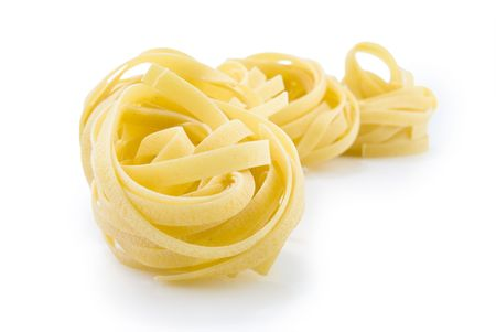 row dry nest pasta on white photo