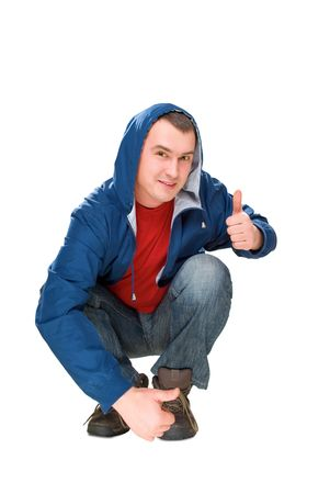 expressing: smile man sit and pointed finger up isolated on white