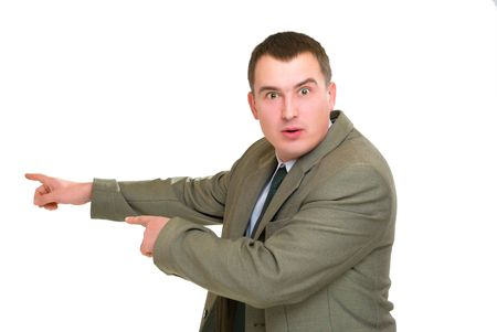 surprised businessman pointed his finger left  isolated on white photo