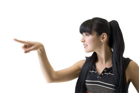 young athletic woman pointing a finger in the direction Imagens