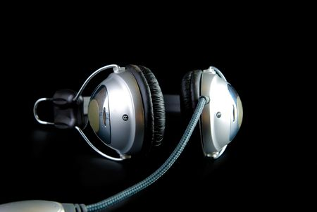 reflaction: headphones with cable and reflaction isolated on black