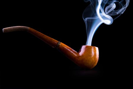deleterious: tobacco pipe with smoke isolated on black Stock Photo