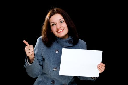 young businesswoman show white blank isolated on black Stok Fotoğraf
