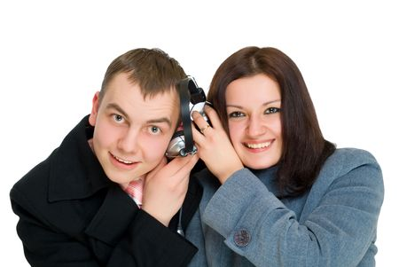 young man and woman listen headphones