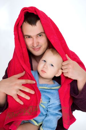 happy young father with a child wraps the towel isolated on white Stock Photo