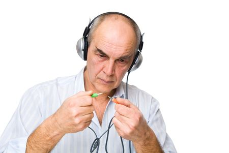 man in headphones  with wires in his hands isolated on white