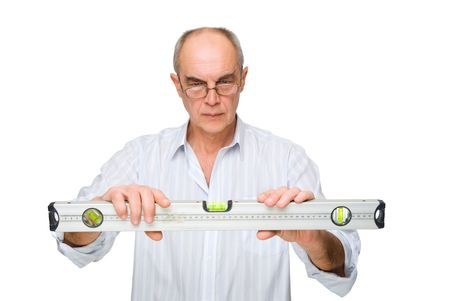 man in glasses looking to  level tool isolated on white