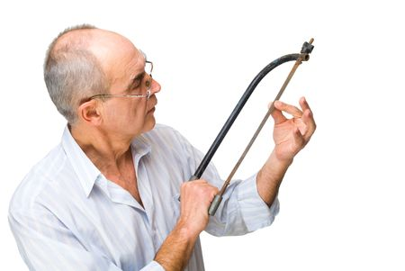 mature man with a saw in shirt thinking about repair isolated on white