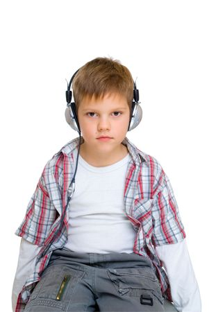 serious boy in headphones isolated on white