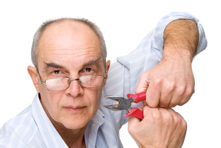serious man in glasses with pliers isolated on white photo
