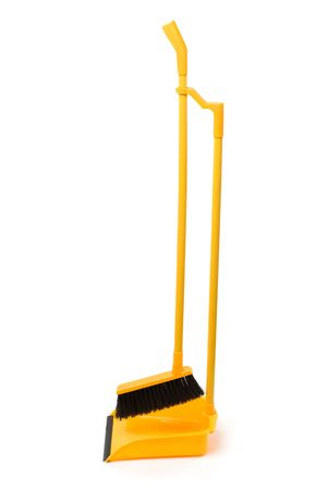 Dustpan and broom isolated on a white background Stock Photo - 6418357