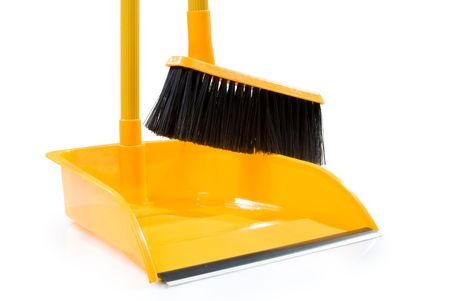 Dustpan and broom isolated on a white background Stock Photo - 6418359