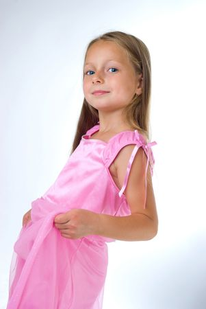 blond girl stand  in pink dress