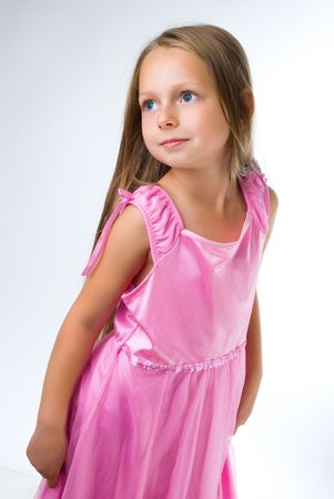 blond girl stand in pink dress and looking left Stok Fotoğraf