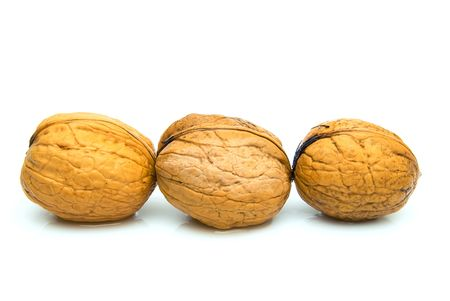 3 nuts isolated on white