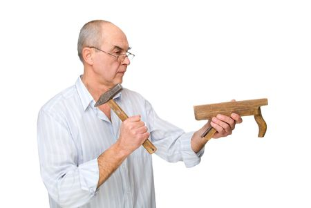 man in spectacles with a hammer and a plane in his hands. Isolated on white background