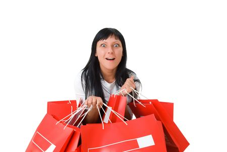 attractive girl with packages, happy after shopping. Isolated on white