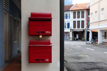 red mailboxes in the background of the old city of Singapore Asia