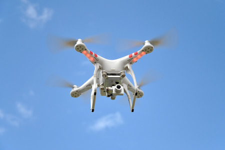 Quadrocopter on blue sky background photo