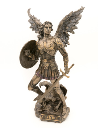 statuette: Bronze statuette of Archangle Michael trampling the devil isolated on white background Stock Photo