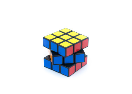 unsolved: Rubiks Cube is isolated on white background