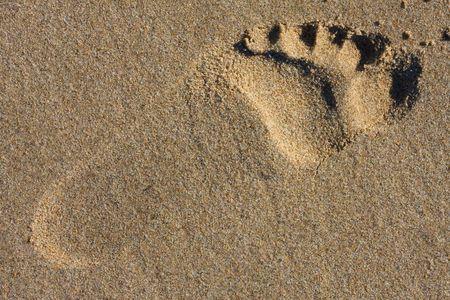 Voet stap in Sand  Stockfoto