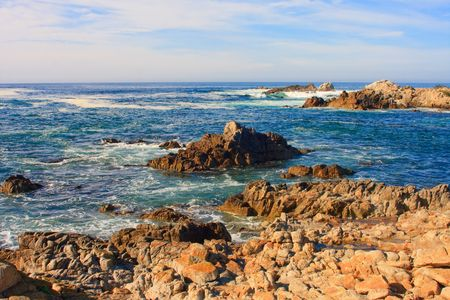 Waves breaking on rocky ocean shore Stock Photo - 6869786