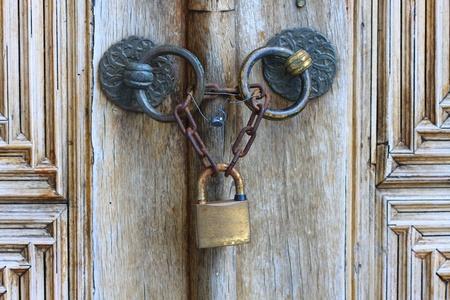 Old iron security lock of ornamental wooden door Stock Photo - 9455522