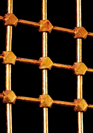 Golden lattice bars with black background photo