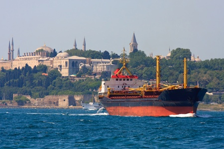 Freighter before Topkapi Palace skyline, Istanbul, Turkey photo