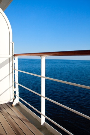Luxurious cruise ship balcony view on blue ocean