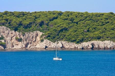 Dalmatian Coastline with sailing boat, Croatia photo