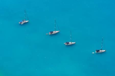 Aerial view of 4 sailing boats near Myrtos beach, Kefalonia, Greece photo