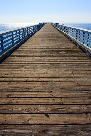 Long wooden Pier before blue sky Stock Photo - 9455871