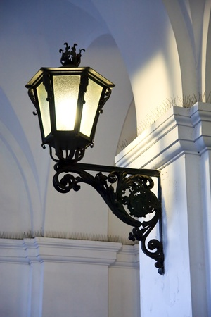 Iron cast street light illuminating old arches Stock Photo - 9455413